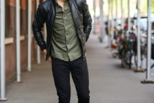 07 black jeans, black sneakers, an olive green shirt and a black leather jacket