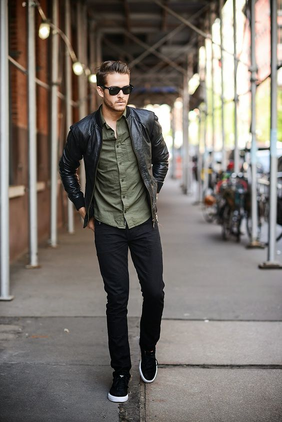 black jeans, black sneakers, an olive green shirt and a black leather jacket