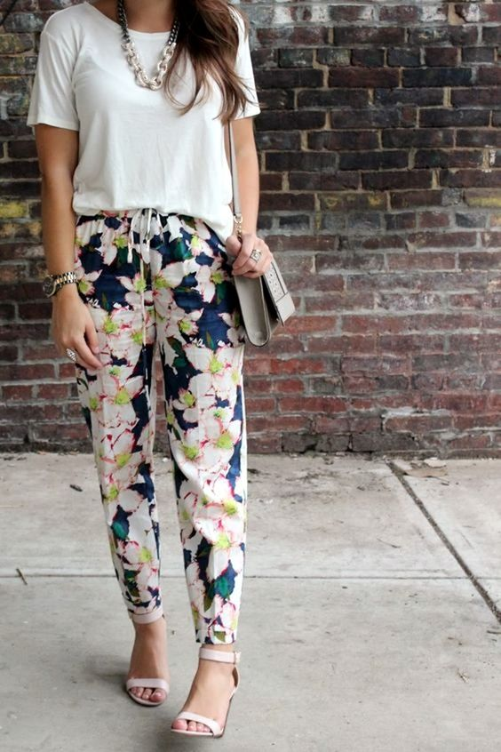 floral pants, a white tee and white shoes