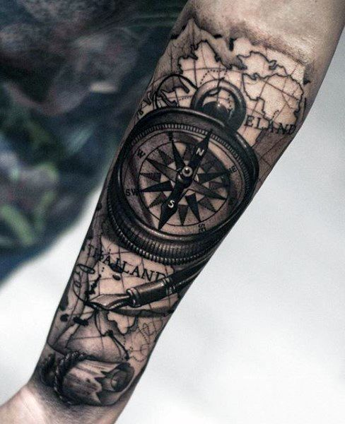 half sleeve man tattoo with a rose compass