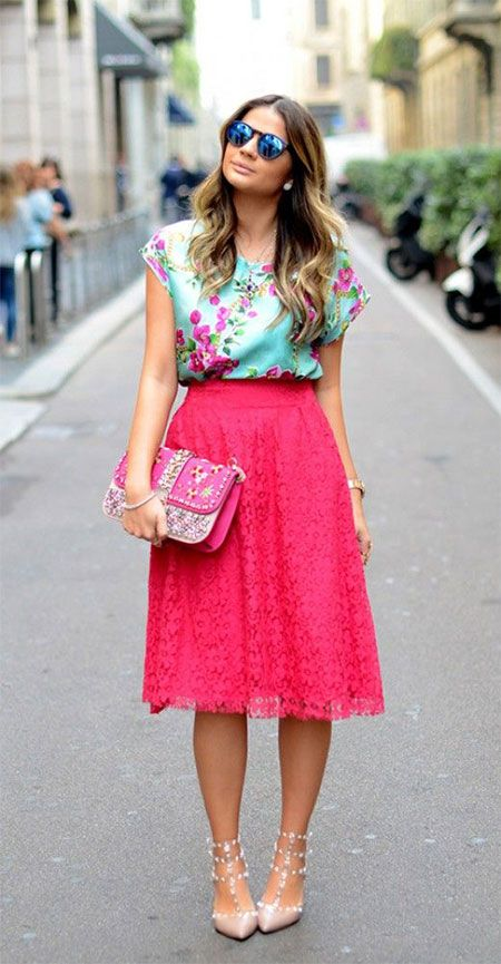 hot pink midi skirt, a green floral top and blush studded heels