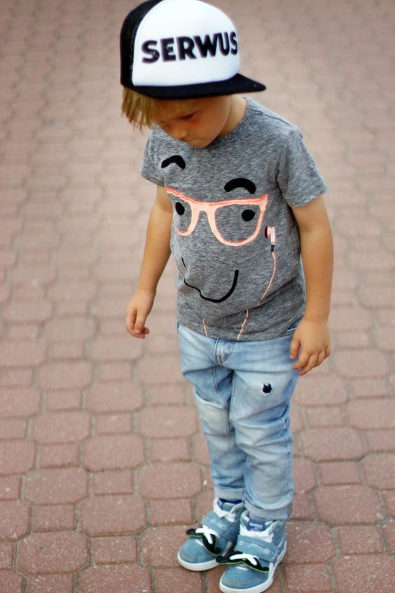 light blue jeans, blue sneakers and a fun printed tee