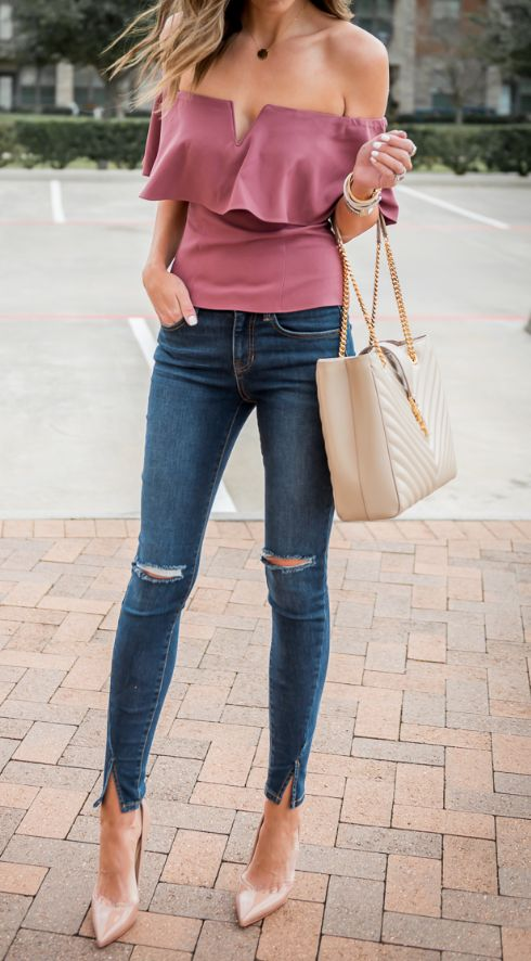 pink red off the shoulder top with a V cut, ripped jeans, nude heels