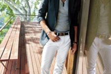 07 white jeans, a black jacket, a grey t-shirt and brown shoes
