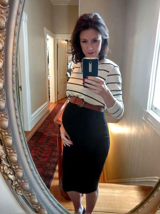 a black midi skirt, a striped top, a belt