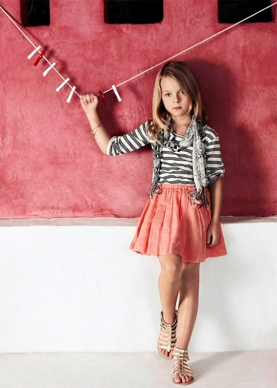 a girl's outfit with a coral skirt, a striped shirt and a scarf, metallic sandals