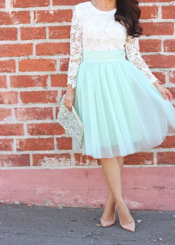 a mint knee skirt, a white lace shirt with sleeves and blush heels
