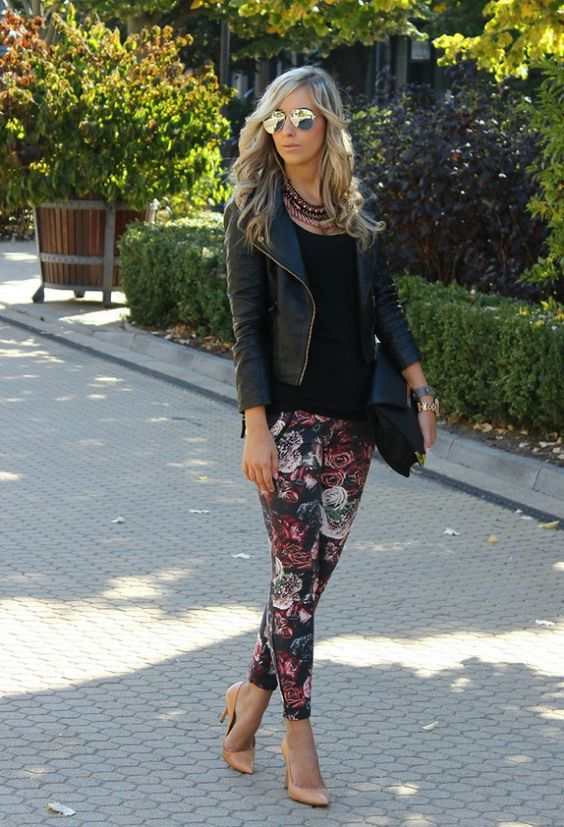 floral pants, a black tee, a black leather jacket and nude shoes