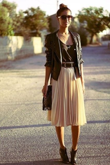 ivory pleated midi skirt, booties, a black top and a black leather jacket