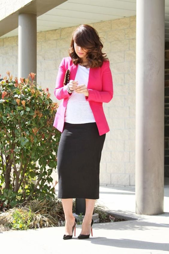 a black midi skirt, a white top, a fuchsia jacket and black heels