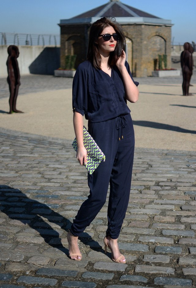 a navy jumpsuit and nude ankle strap sandals