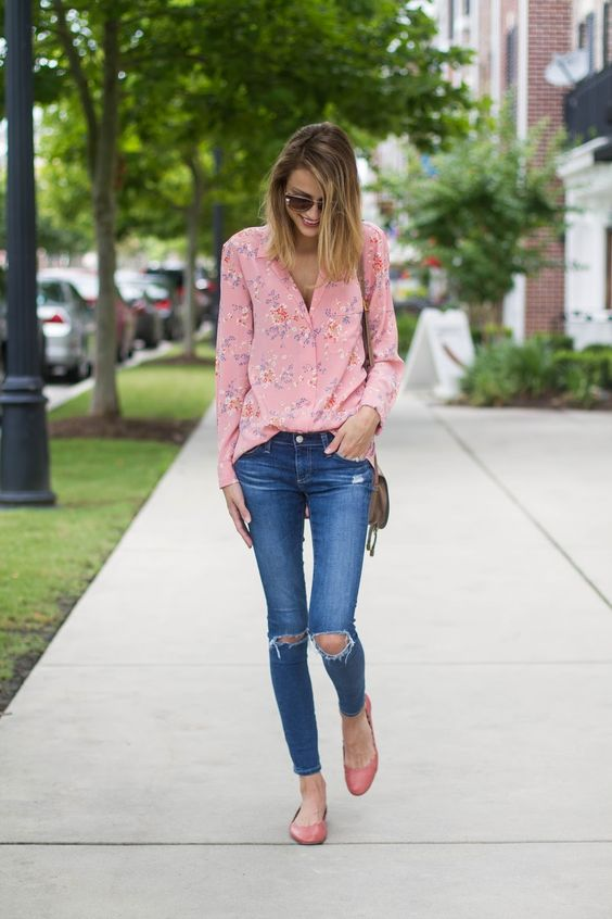 a pastel pink floral blouse with distressed denim skinny jeans