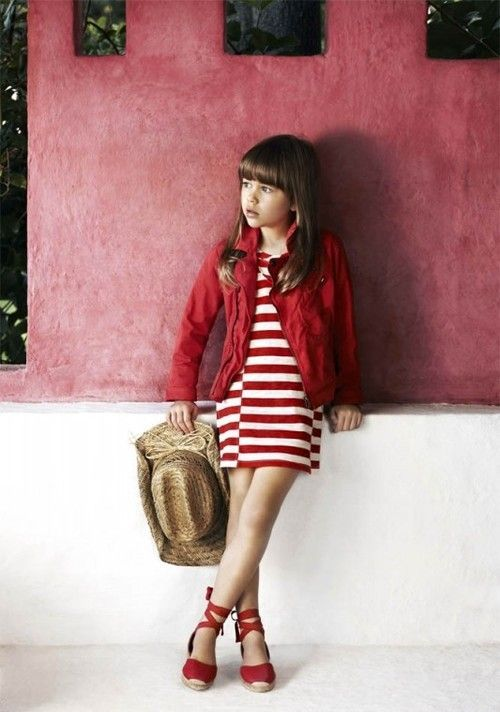 a red striped dress, a red denim jacket and red lace up flats