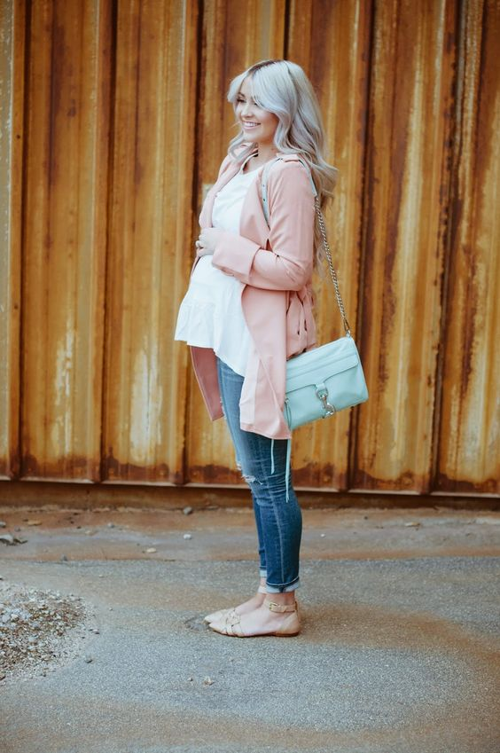 a white blouse, a pink long cardigan and skinny jeans