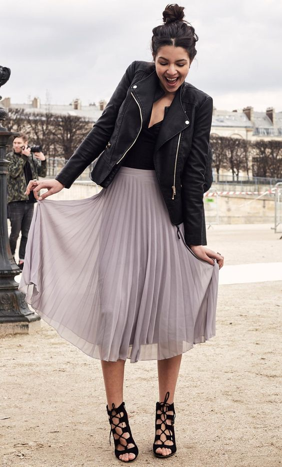 lavender pleated midi, a black top and leather jacket, black lace up heels