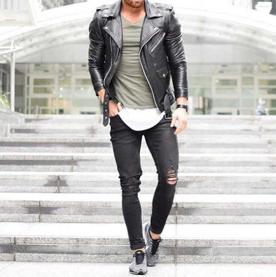 ripped black jeans, layered t shirts, a black moto jacket and chucks