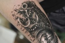 09 rope, anchor, map and a compass 3D tattoo on an arm