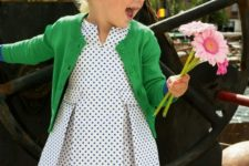 10 a polka dot dress with a sage green cardigan