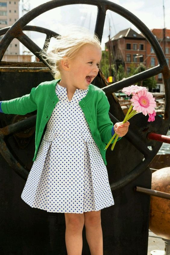 a polka dot dress with a sage green cardigan