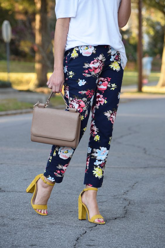 a white tee, navy floral pants and sunny yellow heels