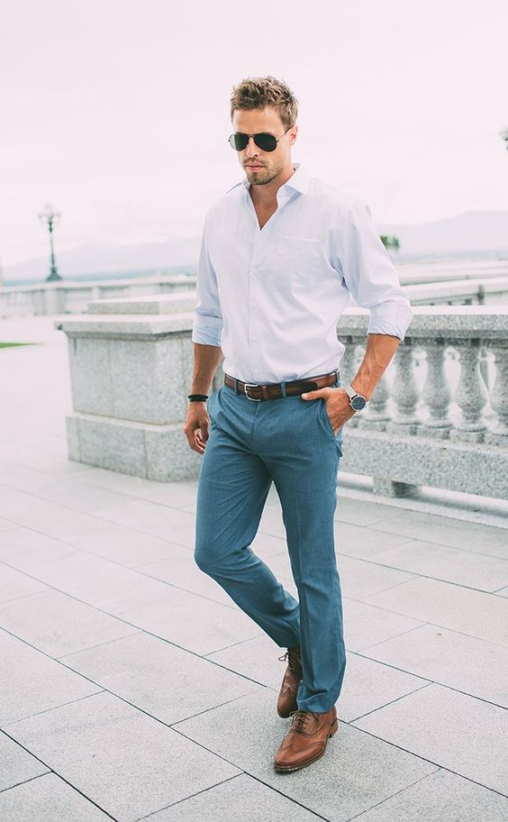 grey pants, a light blue shirt and brown leather shoes