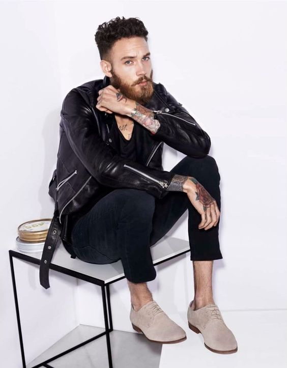 navy denim, a black tee, a leather jacket and ivory suede shoes