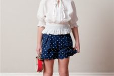 10 vintage-inspired look with ivory flats, a polka dot navy skirt and an ivory shirt with half sleeves