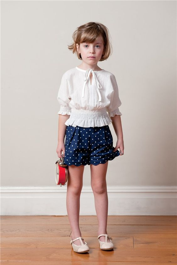 vintage-inspired look with ivory flats, a polka dot navy skirt and an ivory shirt with half sleeves