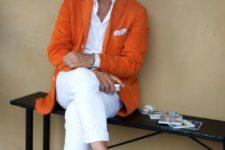 11 a white shirt, white jeans, an orange jacket and white chucks