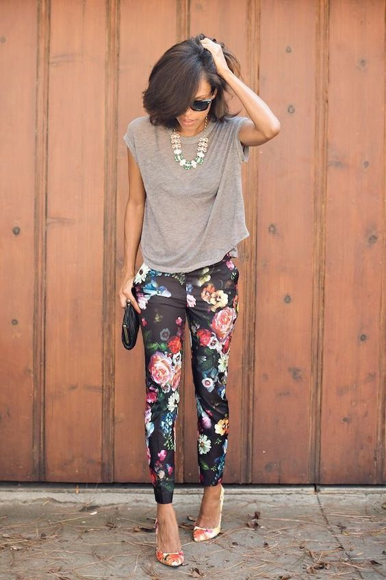 black floral pants, a grey t-shirt and floral shoes