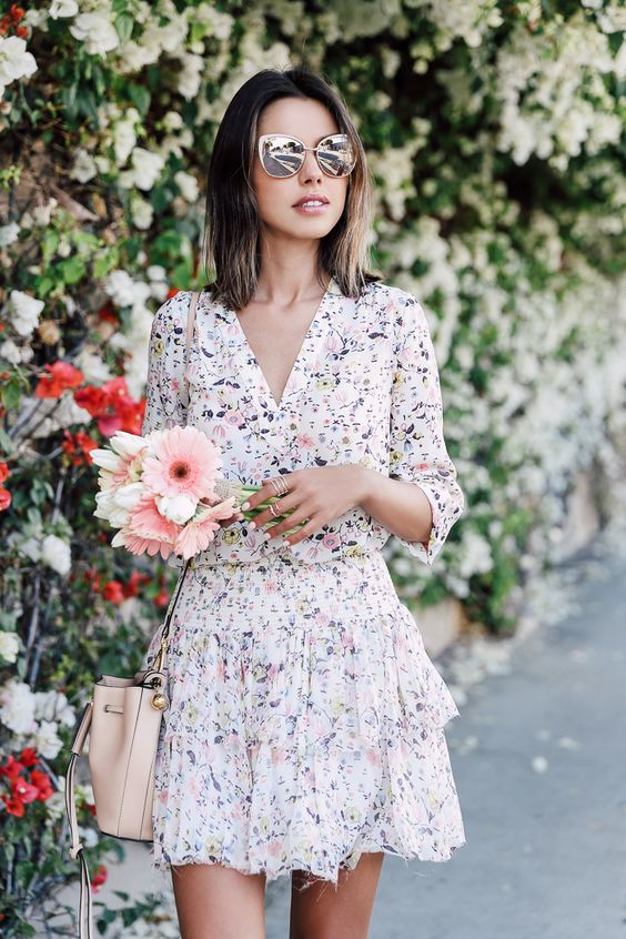 delicate floral mini dress with half sleeves and a V-neckline