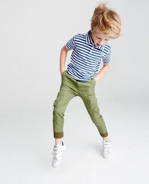 green jeans, a striped tee and white sneakers