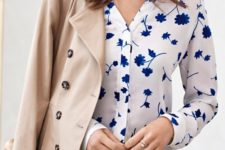 11 navy jeans, a blue floral print blouse and a jacket