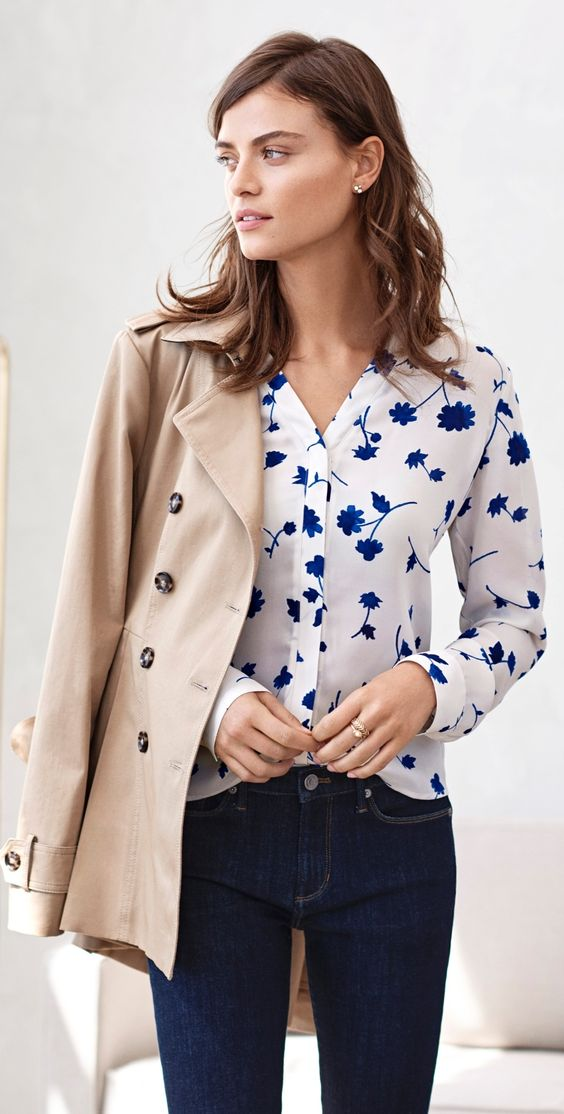 navy jeans, a blue floral print blouse and a jacket