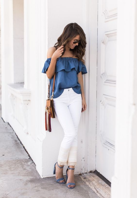 white jeans, a blue off the shoulder top and sandals of the same shade