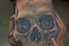 12 a hand skull tattoo is an easy and stylish piece