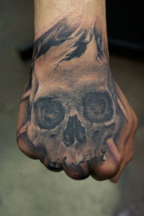 a hand skull tattoo is an easy and stylish piece