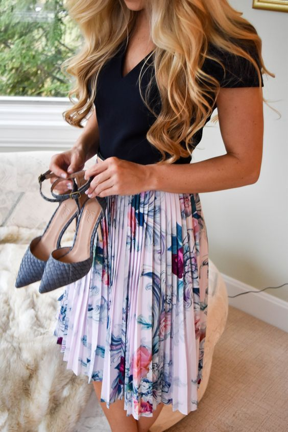a pleated floral knee skirt, a black tee and blue heels