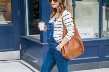 12 a striped shirt, a blue denim overall and white sneakers
