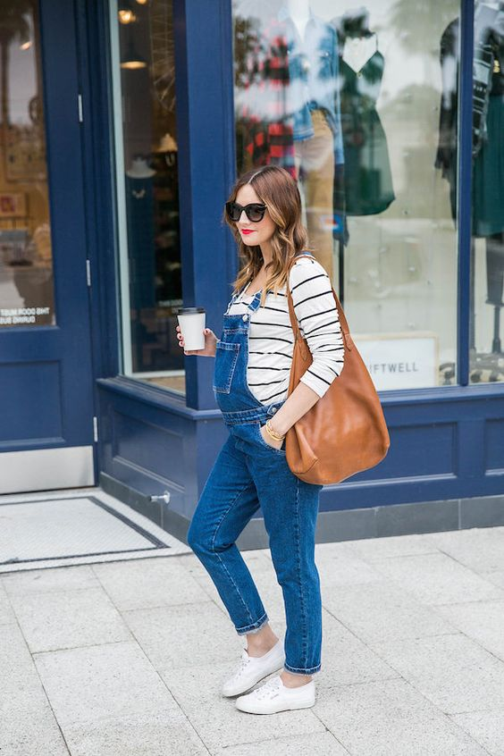 a striped shirt, a blue denim overall and white sneakers