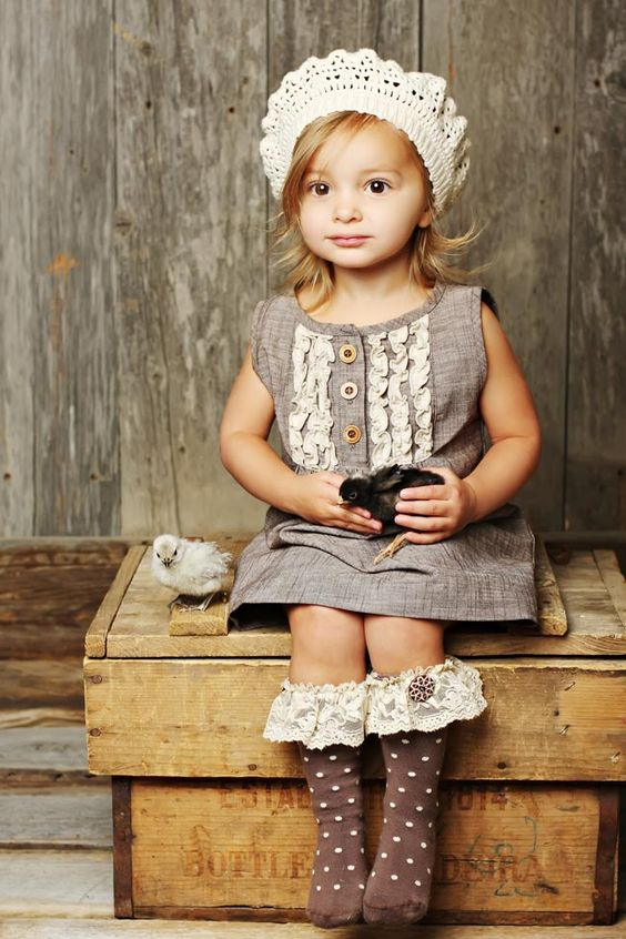 interesting girl's look with a vintage dress, brown socks with lace and a hat