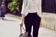 12 black cropped pants, a white blouse, a statement necklace and black sandals with gold details
