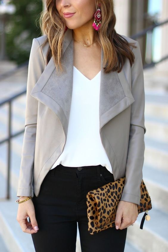 black denim, a white top and a grey leather and suede jacket