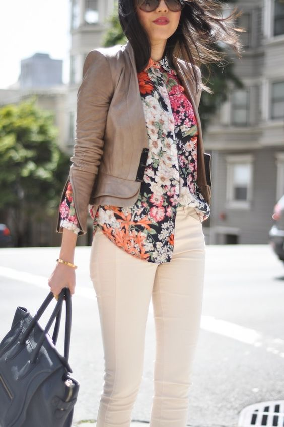 creamy pants, a floral blouse and a brown leather jacket