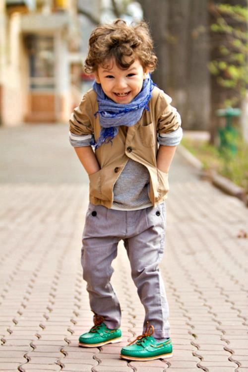 fashionable boy's outfit with grey jeans and a tee, an ocher jacket, green shoes and a scarf