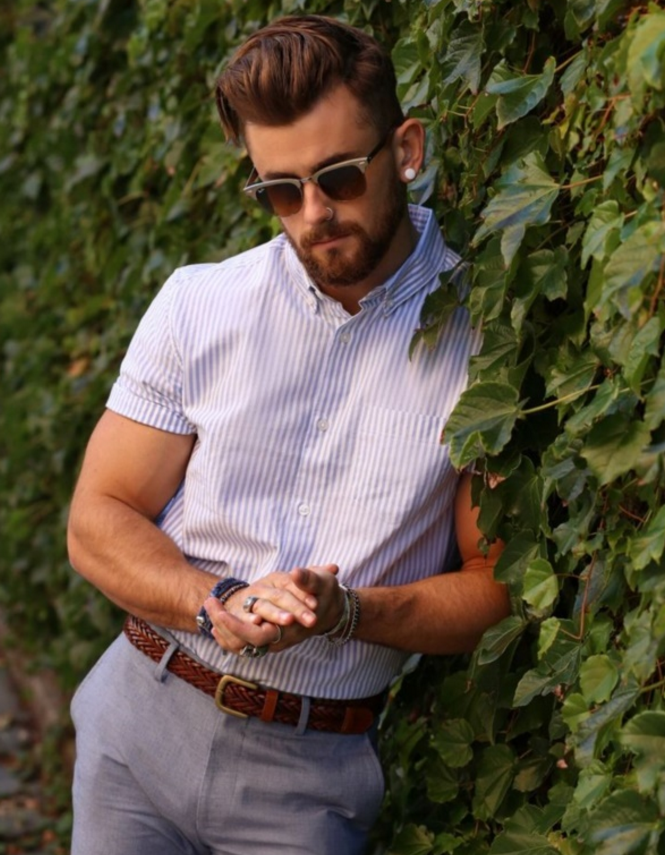 grey pants, a striped shirt with short sleeves
