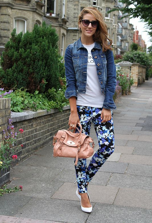 white flats, blue floral pants, a white tee and a denim jacket