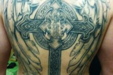 13 a large cross and wings backpiece