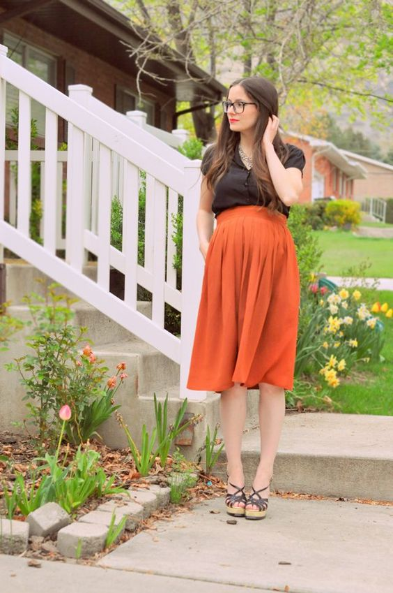 spring maternity office look with a midi orange skirt, a brown shirt and wedges