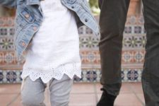 13 a white lace top, a denim jacket, grey pants and grey flats